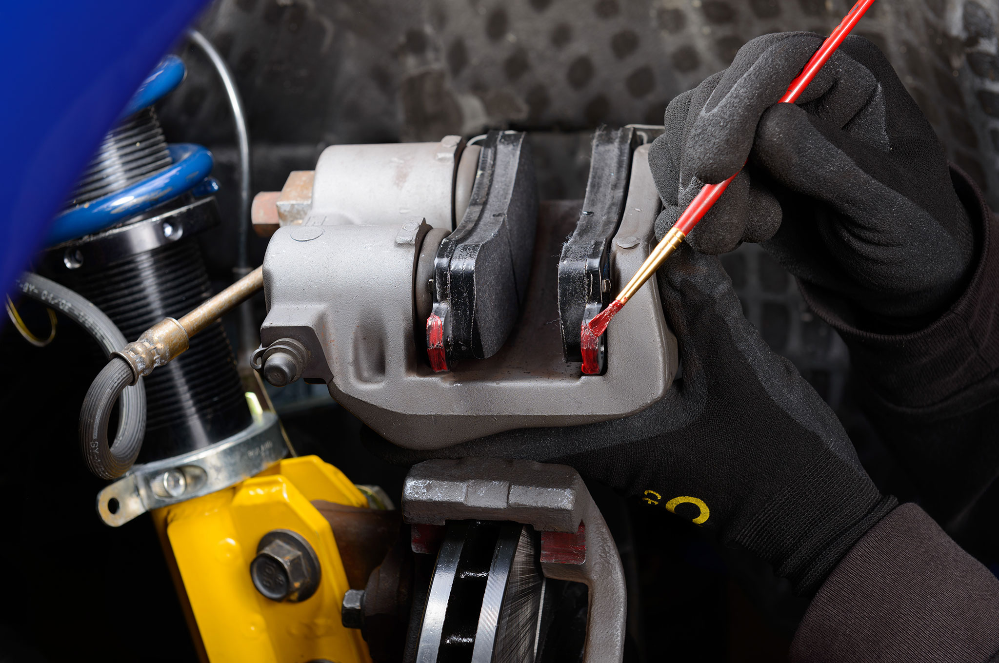 22 2003 Ford Mustang Cobra Applying Thin Layer Of High Temp Brake Parts Lube
