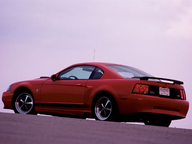 Mump_0401_02_z 2003_ford_mustang_cobra_powertrain_crossbred Red_exterior_side_view