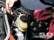 M5lp_0905_04_z 2002_mustang_gt_track Stock_brake_line_removal