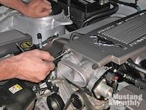 Mump_0903_25_z 2006_ford_mustang_engine Reinstall_throttle_body_bolts