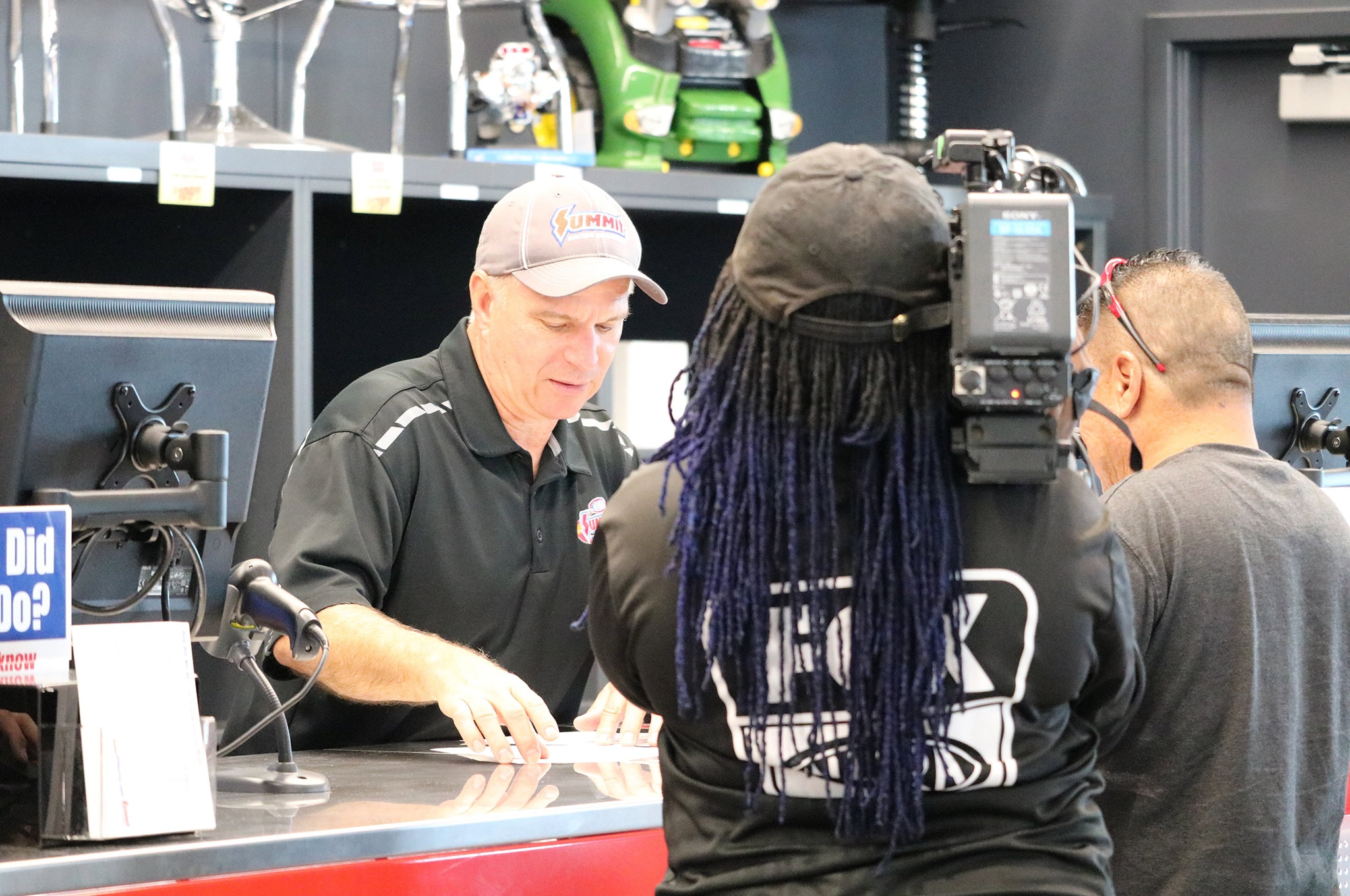 03 Summit Racing TX Retail Store Tim Wilkerson At Customer Pickup Counter