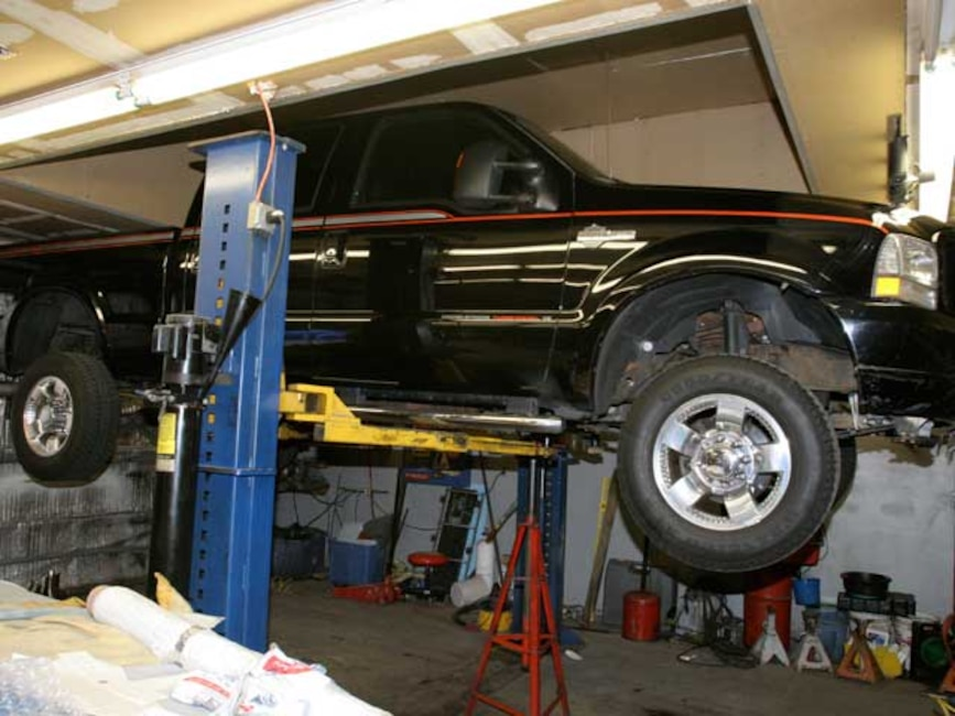 Mmfs_060064_03_z Mbrp_cool_duals_exhaust_install 2004_ford_f350_on_lift