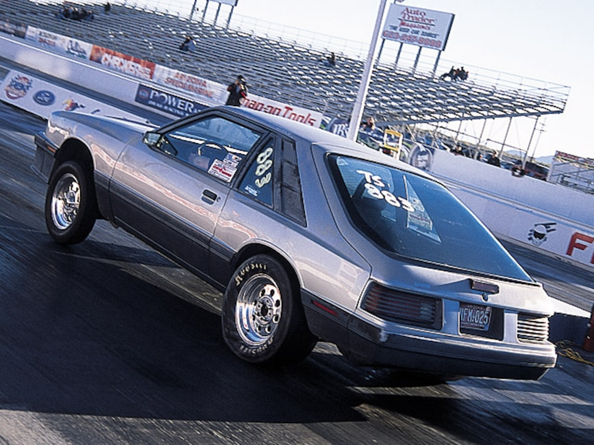 0405mm_37z 1986_Ford_Mustang Rear_Drivers_Side_View_At_Track
