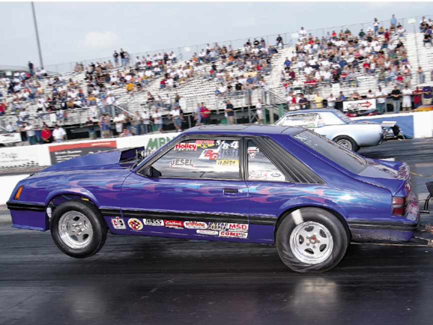 0310mm_13z 1983_Ford_Mustang Drivers_Side_View_At_Track