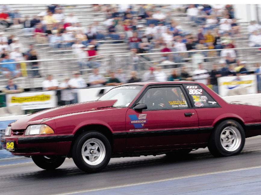 0310mm_29z Ford_Mustang Drivers_Side_View_At_Track