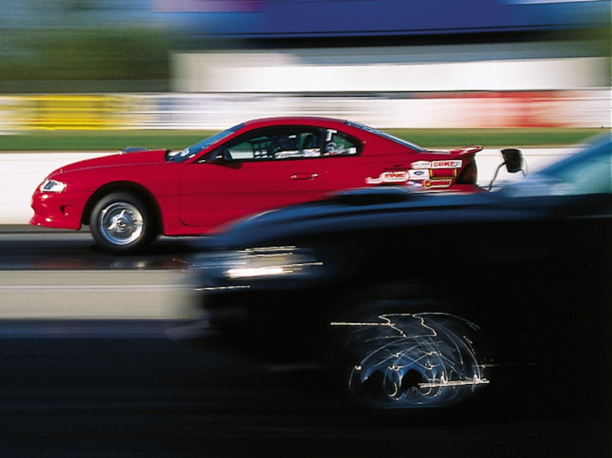 0308mm_04z Ford_Mustang Drivers_Side_View_At_Track