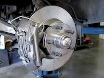 Mump_0605_01_z 1967_ford_mustang_disc_brake_install Rotor_caliper