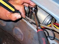 Mump_0702_10z Ford_mustang Replacing_convertible_top_motor