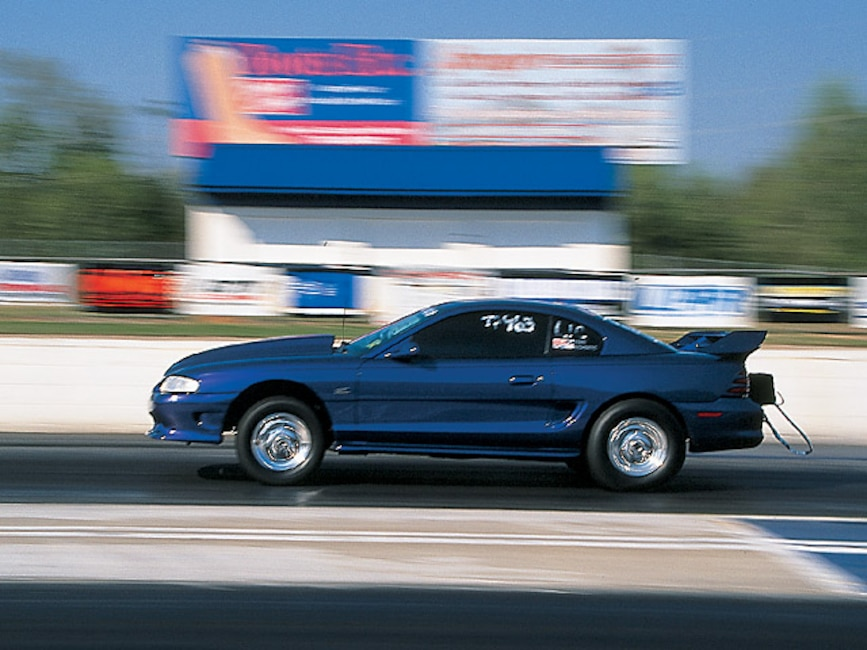 0408mm_11z 1995_Ford_Mustang Driver_Side_View_At_Track