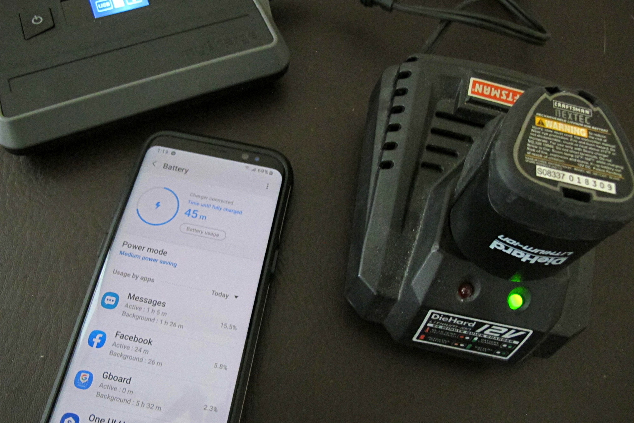 09 AdventureUltra Power Bank Powering Power Tool Charger And Charging Smart Phone