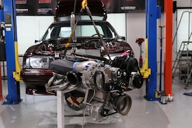 Week To Wicked, Day 3: Installing the Engine, Transmission, and Measuring the Driveshaft in our 1990 Fox-Body Mustang
